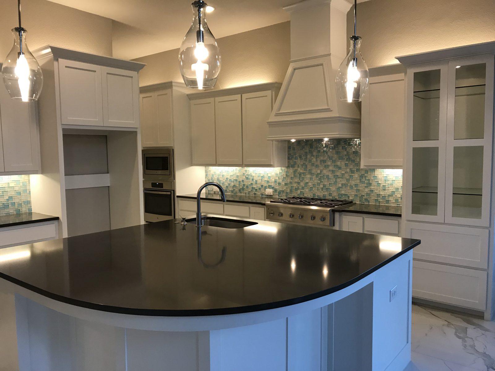 Quartz Countertops, Backsplash, and floor tile in Frisco