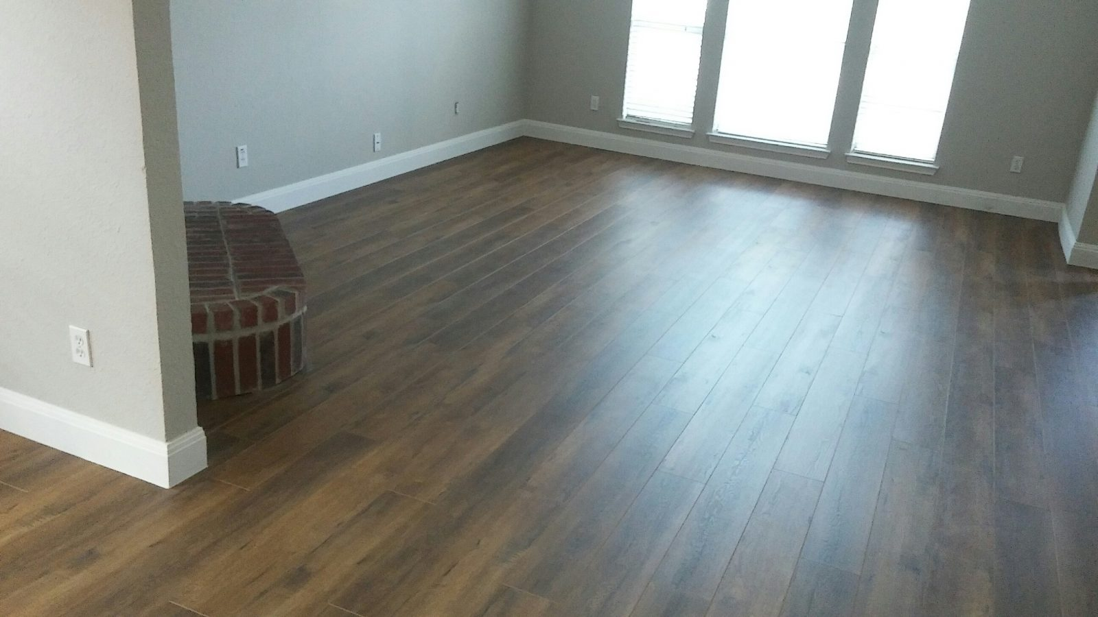 New Laminate Floors, Baseboards, and Paint Ft Worth, TX