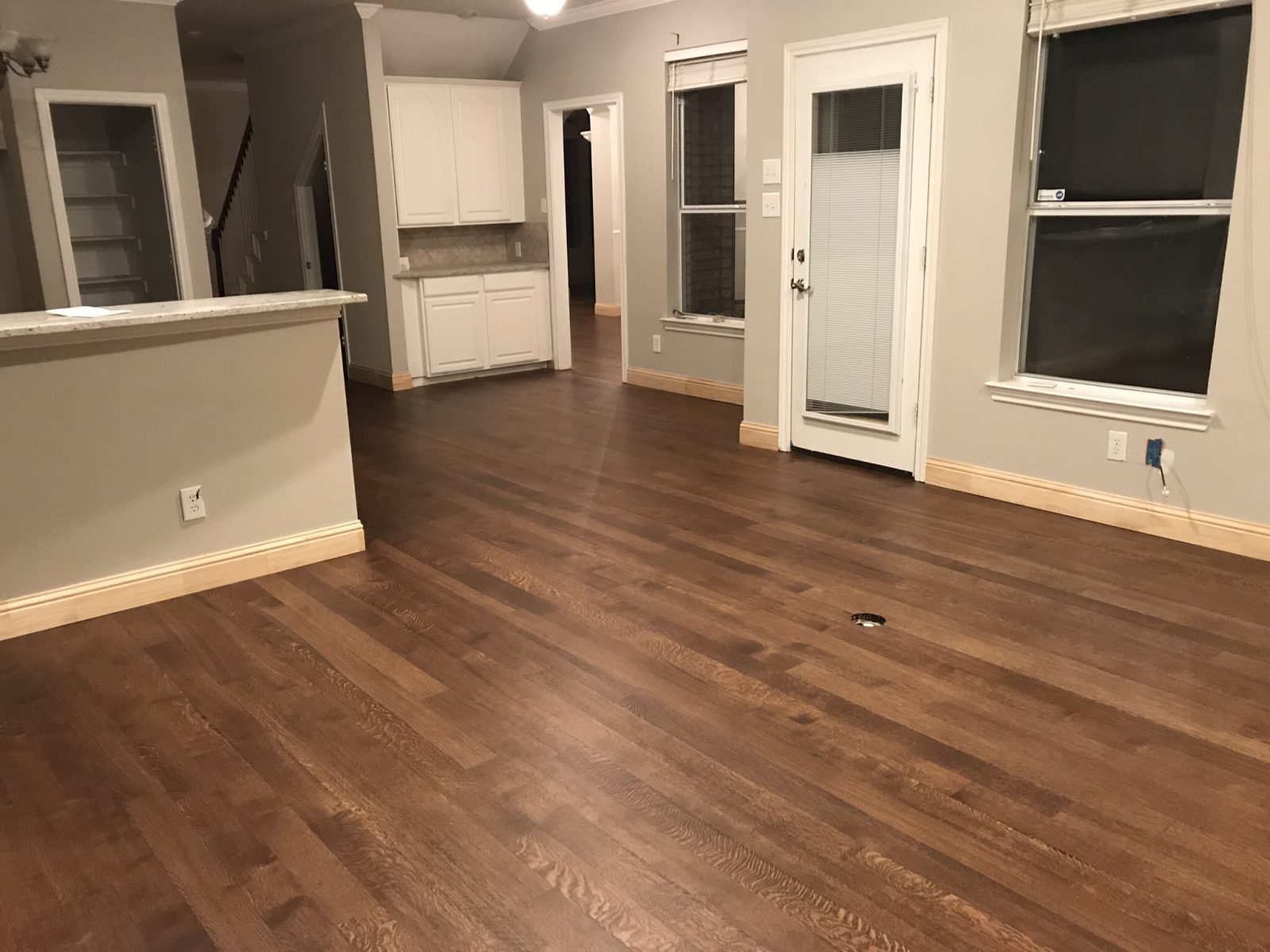 Solid Rift and Quartered White Oak Floors and solid wood baseboards in Frisco Texas